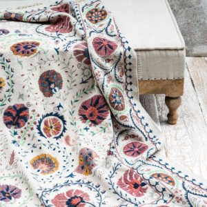 Eva-Embroidered-Rug-on-pouff-Dassie-Artisan